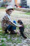 Child petting a cat Stock Images