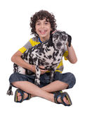 Child petting female dalmatian dog Royalty Free Stock Image