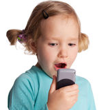 Child with phone Royalty Free Stock Photos
