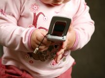 Child with the phone stock images