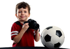 Child with photo camera and soccer ball Stock Photo