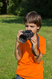 Child with photocamera Stock Photography