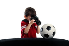 Child photographed a soccer ball Stock Photo