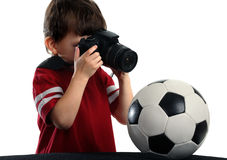 Child photographed a soccer ball Royalty Free Stock Image