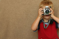 Child Photographer with copy space. Young boy taking a picture with his camera Royalty Free Stock Image