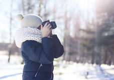 Child photographer takes picture on the digital camera outdoors Stock Photo