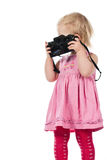 Child photographing. Child playing as photographer isolated on white Stock Photography