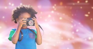 Child photographing over blue background. Digital composite of Child photographing over blue background Royalty Free Stock Photo