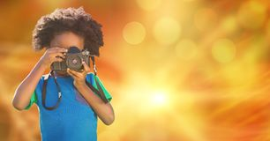 Child photographing over blur background. Digital composite of Child photographing over blur background Royalty Free Stock Photography