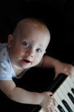 Child at piano Royalty Free Stock Photography