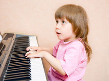 A child at the piano Royalty Free Stock Photos