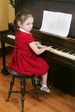 Child at the piano Stock Photo