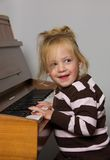 Child with piano Stock Image
