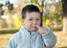 Child picking nose. Portrait of a child picking up his nose Stock Photography