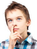 Child picking nose. Portrait of dreamy boy picking his nose Stock Photo