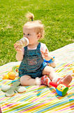 Child, on a picnic, drinking water from a bottle Royalty Free Stock Images