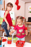 Child with picture and brush painting in playroom. Stock Photography