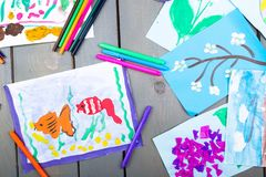 Child pictures. Kid drawings. Child pictures. Top view.  Kid drawings Flat lay Royalty Free Stock Photos