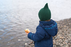 Child with a piece of bread Royalty Free Stock Photography