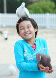 Child and pigeon Royalty Free Stock Photos