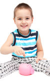 Child with piggy bank Stock Image