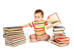 The child and a pile of books Royalty Free Stock Photos