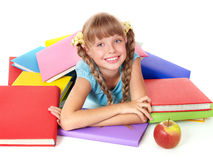 Child with pile of books and apple. Stock Photo