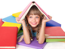 Child with pile of books on head. Stock Photography