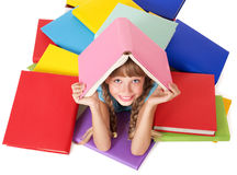Child with pile of books on head. Stock Images