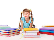 Child with pile of books  lying on floor. Stock Photo