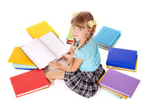 Child with pile of books reading on floor. Royalty Free Stock Photo