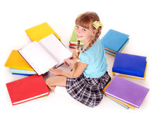 Child with pile of books reading on floor. Stock Images