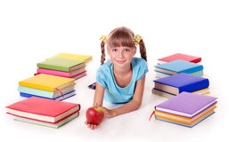 Child with pile of books reading on floor. Royalty Free Stock Photography