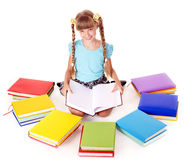 Child with pile of books reading on floor. Royalty Free Stock Photos