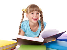 Child with pile of books reading on front Royalty Free Stock Photo