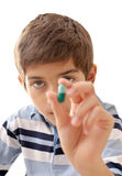 Child with pill Royalty Free Stock Photos