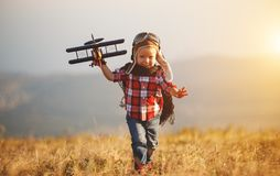 Child pilot aviator with airplane dreams of traveling in summer Stock Images