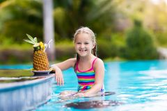 Child with pineapple juice in pool bar stock images