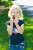 Child with pinecone. Royalty Free Stock Image
