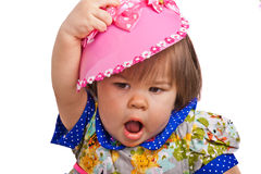 Child in a pink bonnet Royalty Free Stock Photography
