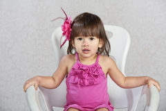 Child with Pink Ribbon in Hair Stock Photography