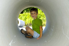 Child in a Pipe royalty free stock photo