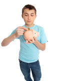 Child placing coins into a piggy bank Royalty Free Stock Photo