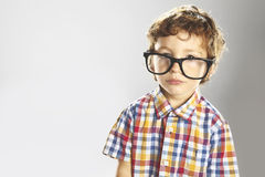 Child with plaid shirt and glasses Royalty Free Stock Images