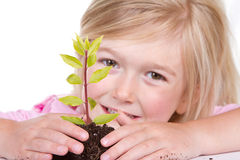 Child with plant smiling Stock Images