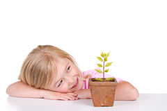 Child with plant smiling Royalty Free Stock Photography