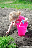 Child Planting Stock Photo