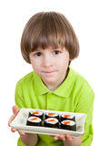 Child with plate of asian rolls Royalty Free Stock Photo