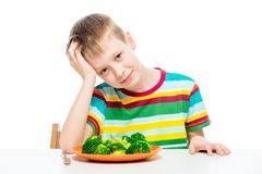 Child and a plate of broccoli, concept photo food. And children stock photos