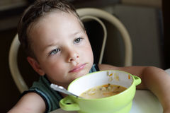 Child with plate of soup Royalty Free Stock Photography